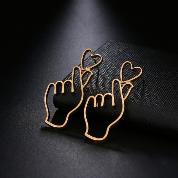 Gold plated funny hand heart earring